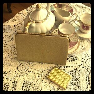 Vintage gold lamay thin clutch w/ chain.